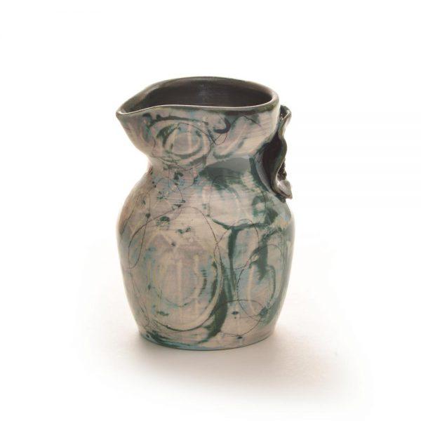 blue green ceramic creamer with flower detail