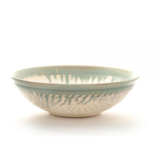 white carved ceramic handmade bowl with drippy light green rim
