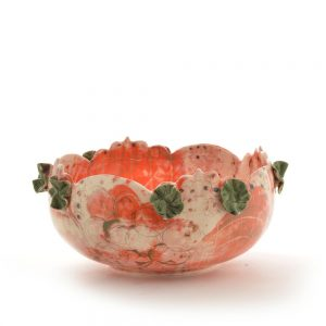 large orange white and green decorative bowl, hand built ceramic bowl with orange decoration and green flowers around the rim