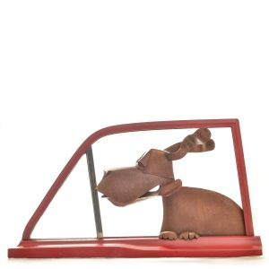 dog in car window wall sculpture