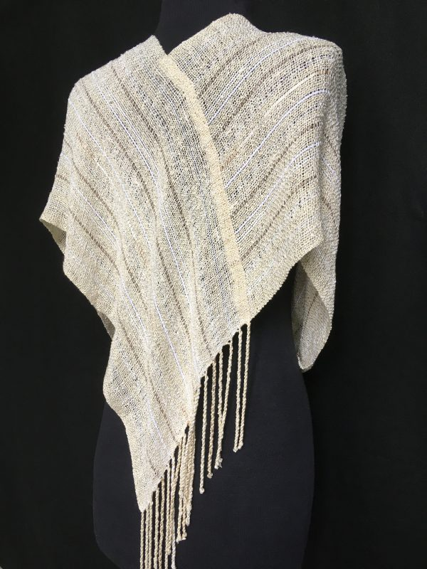 back view of handwoven ivory swoop, handwoven poncho
