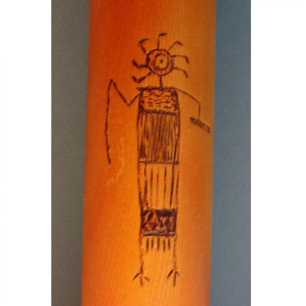 detail of wood burned decoration on wooden handmade flute