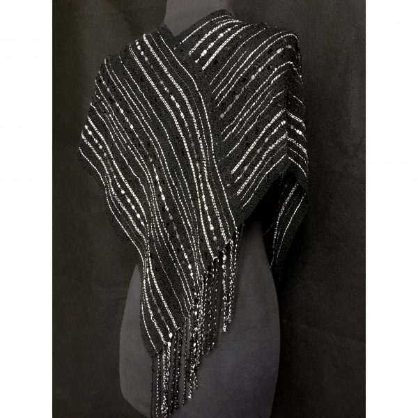 back view of black and silver handwoven twisted poncho
