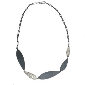 handmade oxidized silver necklace with feather shapes linked together