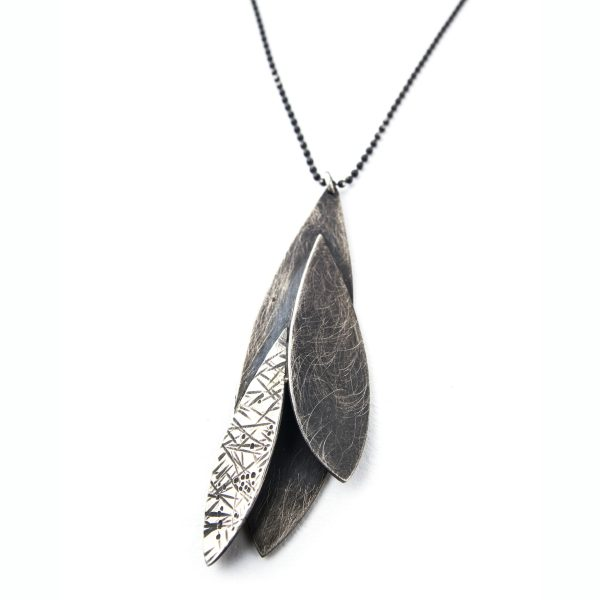 oxidized silver necklace made with textured feather shapes stacked on eachother