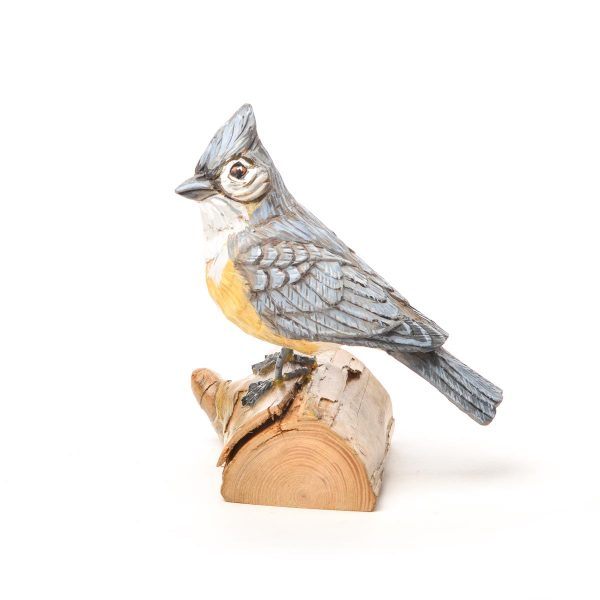 hand carved and hand painted titmouse standing on a wood log, virginia bird carver