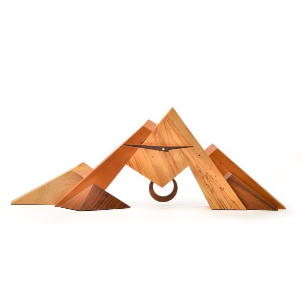 long wide wooden handmade clock that looks like a mountain with different woods and a pendulum