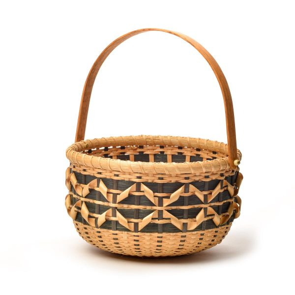 black and natural handmade basket with large swing handle