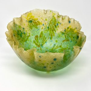 green pate de verre vessel with oak leaf design