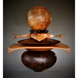 handmade wooden totem sculpture using multiple woods