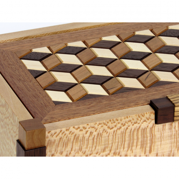 detail of wooden jewelry box with tumbling block pattern