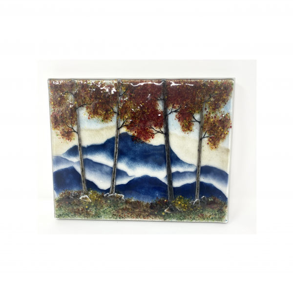 red leaf fall mountain landscape in fused glass mounted on a wood panel