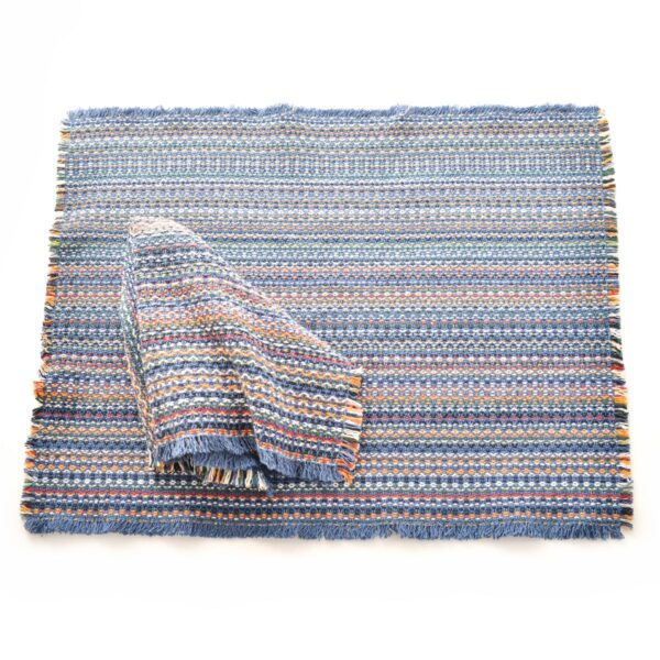 slate blue handwoven multicolored napkins and placemats