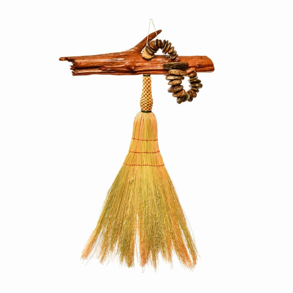 artistic handmade broom with drift wood and river rocks, handmade mountain home decor