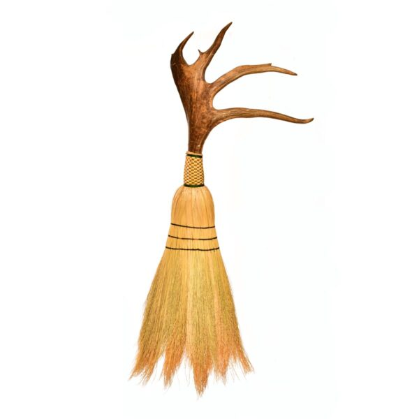 artistic broom with caribou antler as the handle