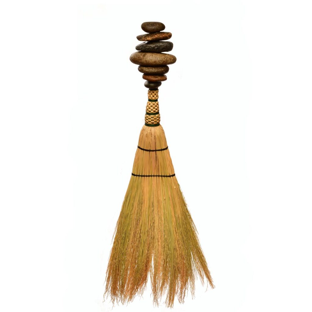 artistic handmade broom with stacked rocks for the handle, rock cairn, stacking rocks broom, traditional crafts