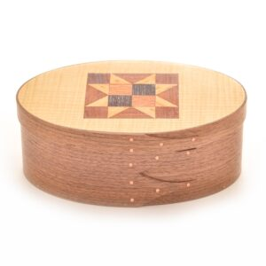 walnut oval shaker box with quilt pattern in lid