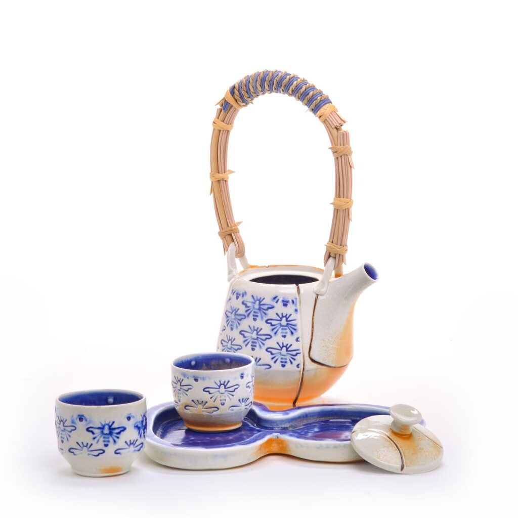 bee stamped handmade porcelain teapot set with 2 cups and a tray
