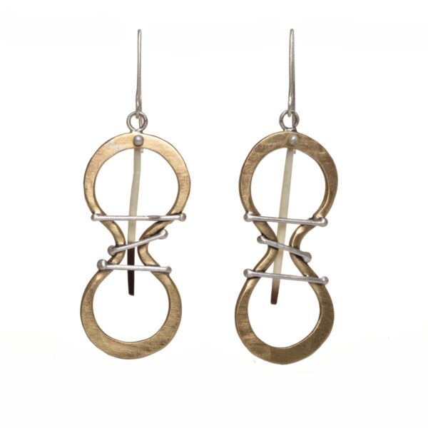 brass handmade earrings with brass infinity shapes with silver bars and porcupine quills