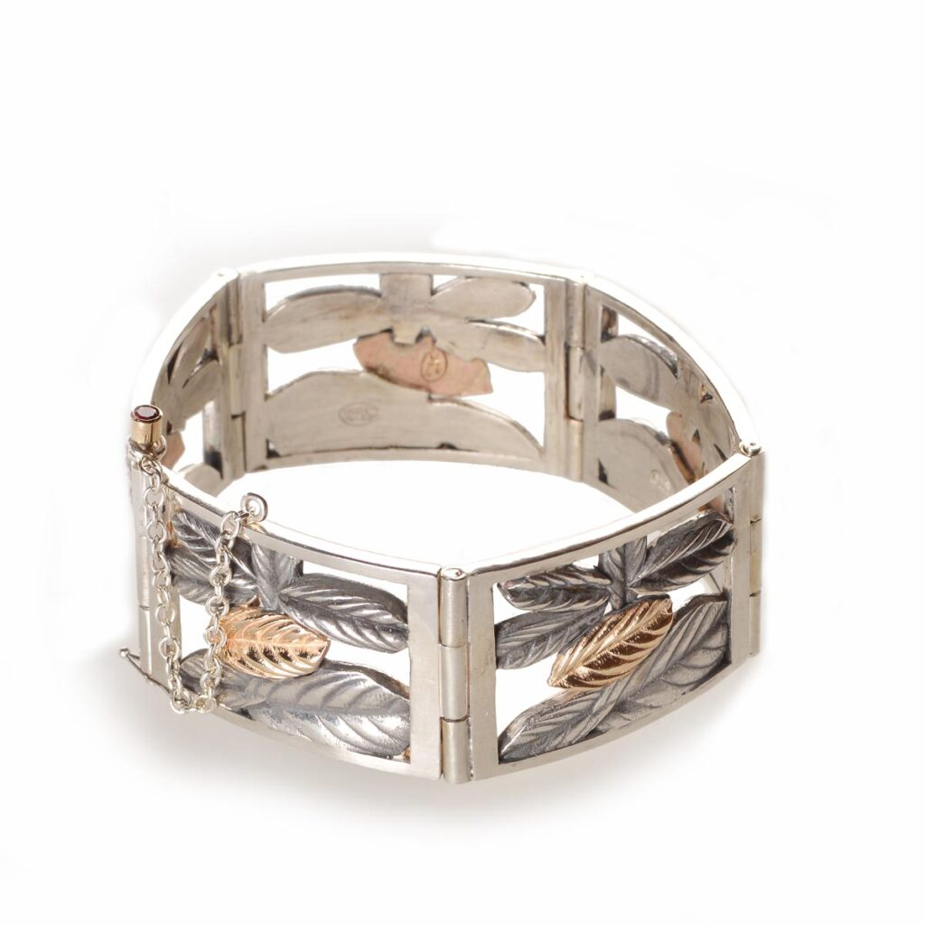 silver and gold handmade bracelet with leaves