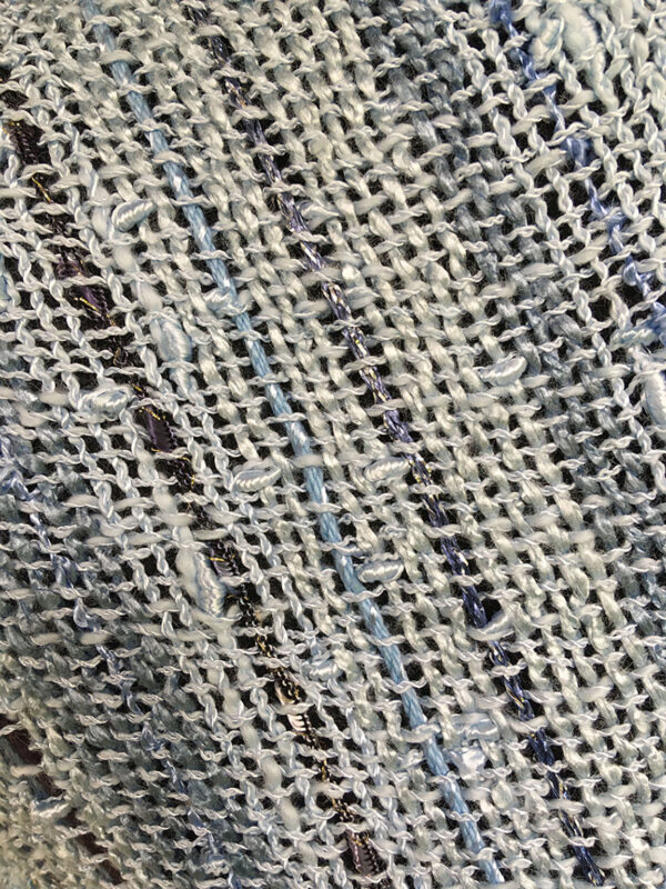 light blue swatch of handwoven light blue fabric for swoop shawl