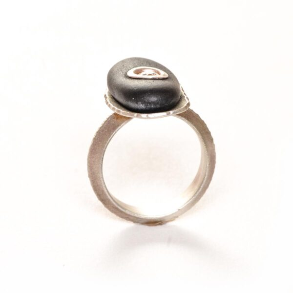 river rock pebble ring with silver and a cubic zirconia