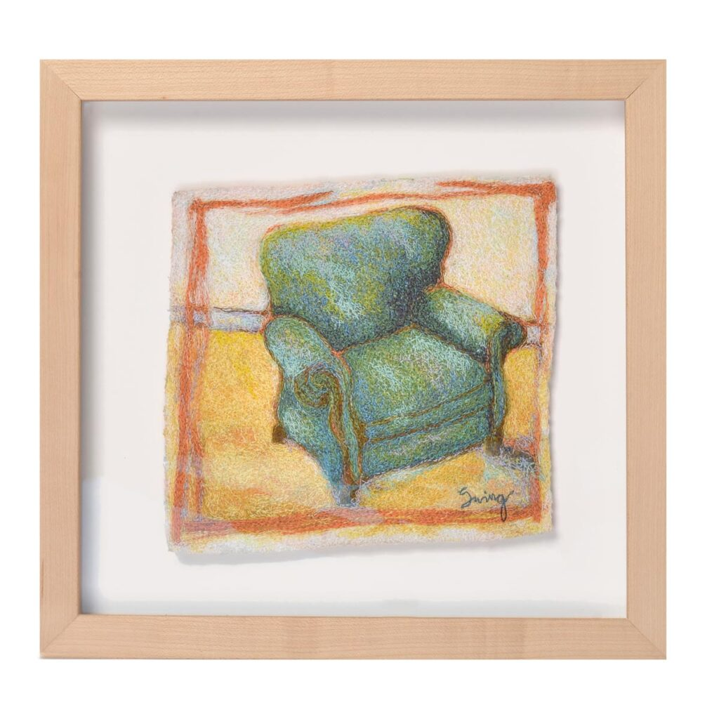 framed embroidery of a recliner