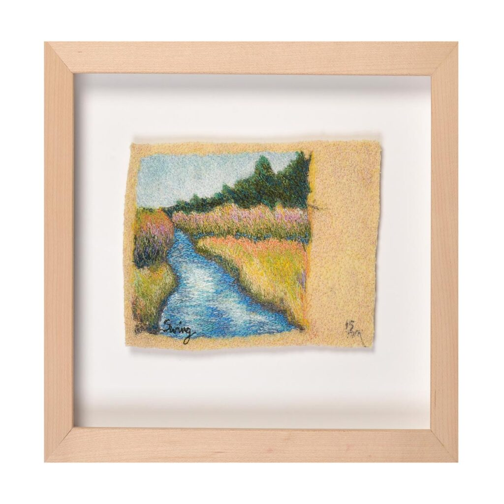 embroidered landscape image of stream, framed embroidery landscape