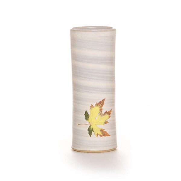 white tall ceramic vase with leaf decoration