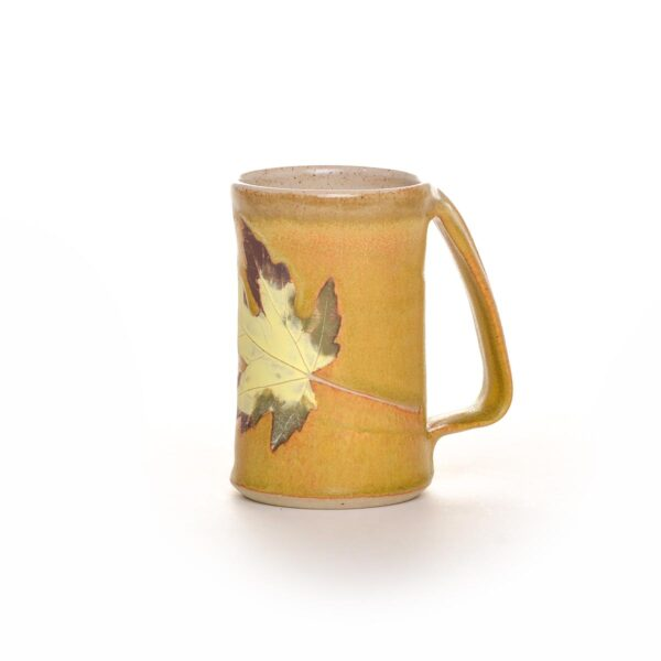 yellow leaf handmade ceramic mug with unique handle.