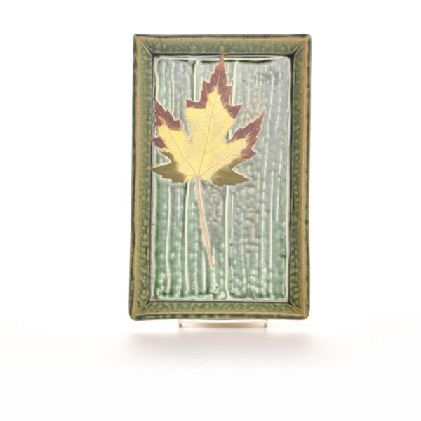 green ceramic green tray with leaf decoration
