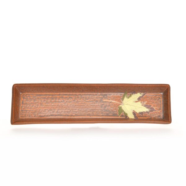 brown ceramic bread tray with brown drippy glaze and leaf decoration