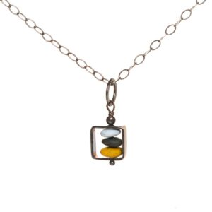 sweet little square necklace with a stack of small pebbles