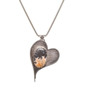 handmade oxidized silver heart necklace with petrified palm room accent