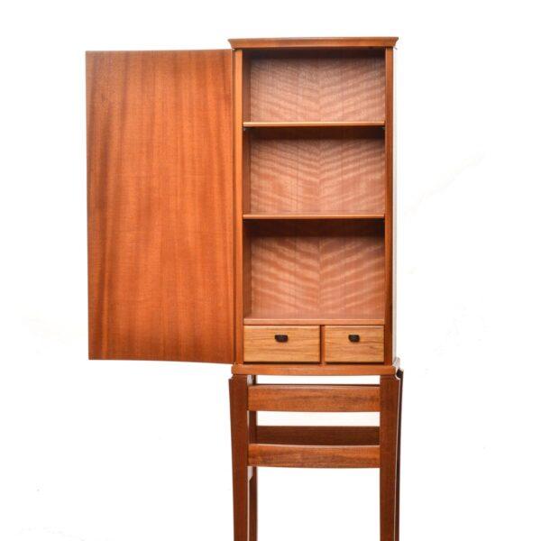 handcrafted wooden cabinet with open door detail