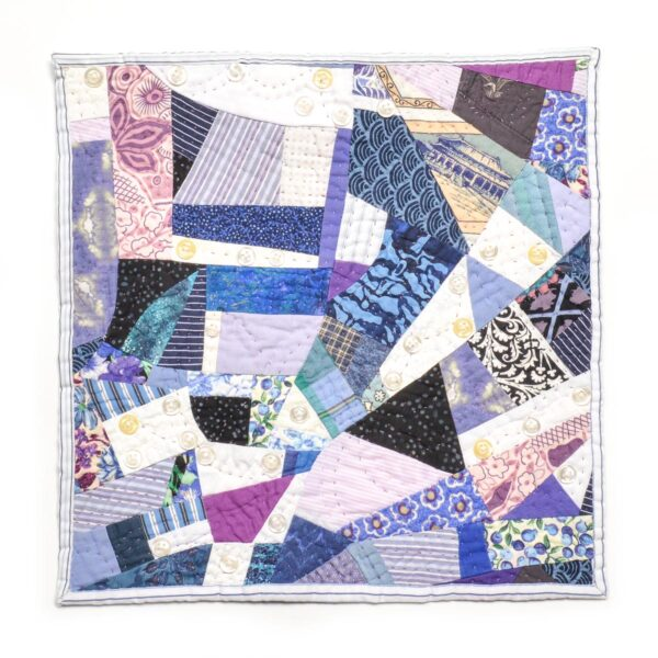 blue white and black hand pieced small quilt wall hanging