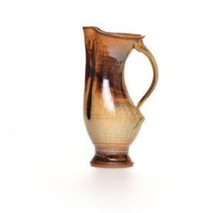 wheel thrown brown pitcher with drippy glaze,