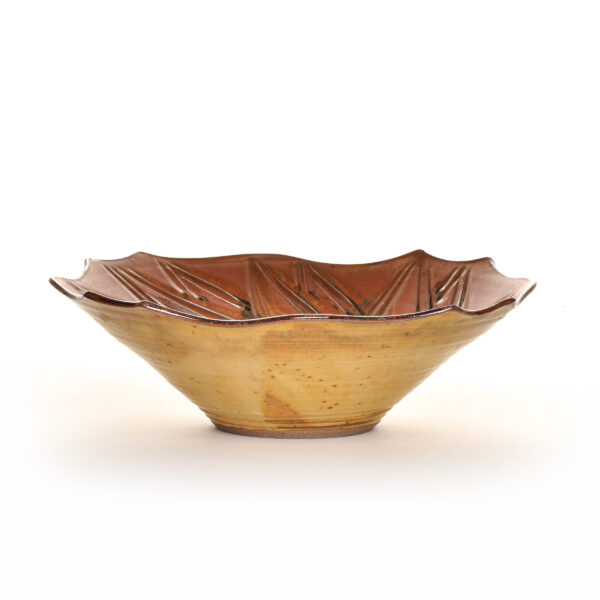 large brown ceramic serving bowl with carved petals in the inside, village potters asheville, woman potter, asheville clay artist
