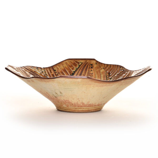 squared large brown ceramic serving bowl with carved petals in the inside, village potters asheville, woman potter, asheville clay artist