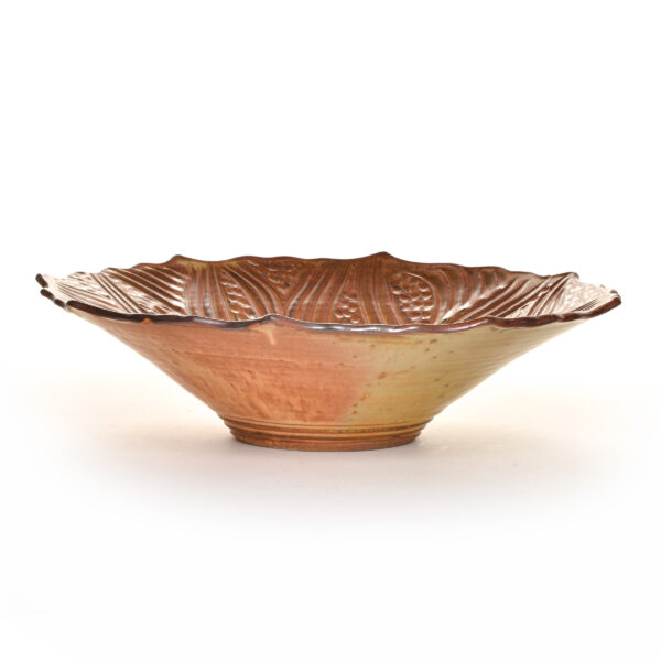 brown wheel thrown carved serving bowl