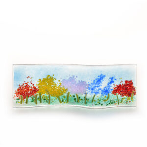 colorful rainbow of flowers in glass, small tabletop glass flower landscape