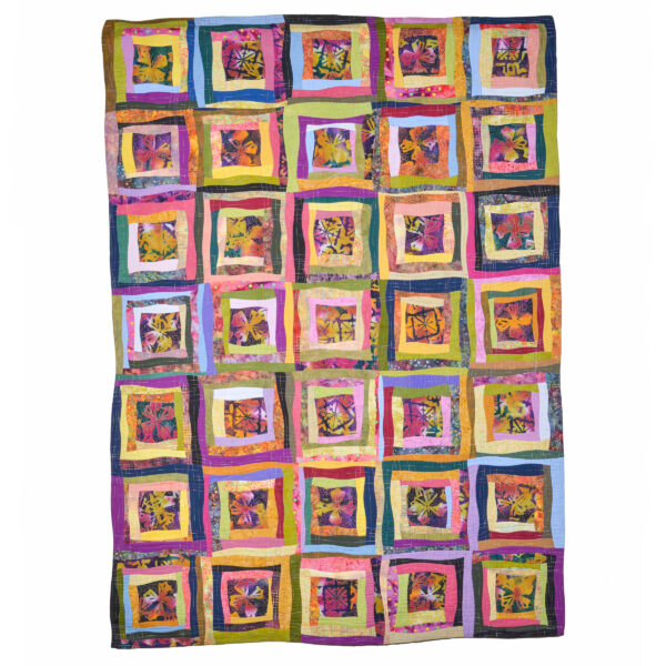 colorful handmade quilt with flowers