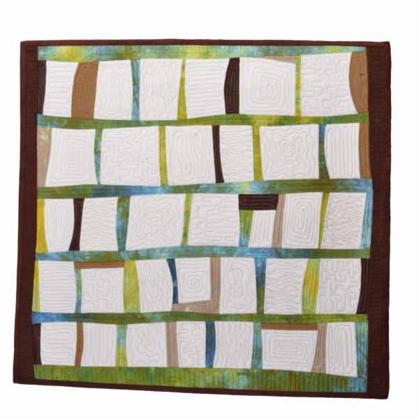 handmade quilt with color and white square with black boarder