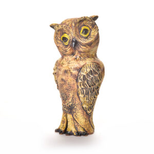 handmade ceramic owl sculpture with yellow eyes