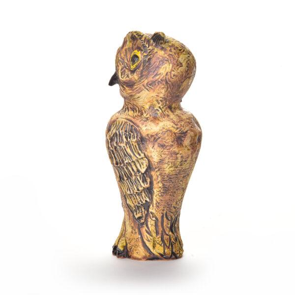 handmade ceramic owl sculpture with yellow eyes
