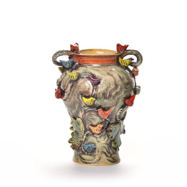 wheel thrown ceramic vase with birds all over it
