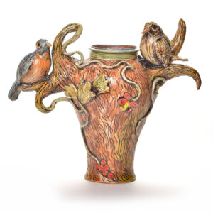 sculptural ceramic vase with birds perched on the handles, blue bird clay vase