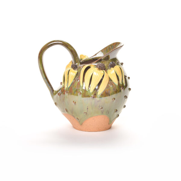 handmade ceramic green pitcher with yellow coneflowers and dogs
