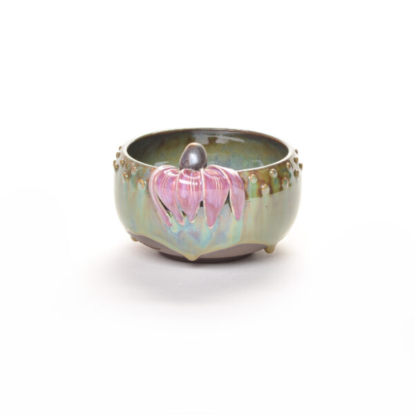 ceramic bowl with green blue glaze and purple cornflower around the rim