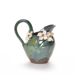 ceramic handmade pitcher with green glaze and white dogwood flowers